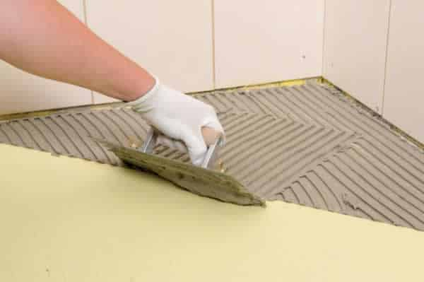 How to tile a bathroom floor - applying the adhesive