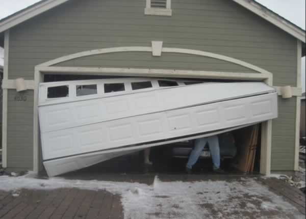 Garage door repair - garage door off tracks