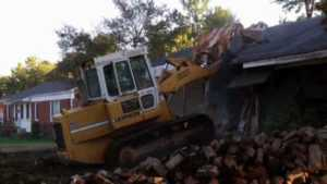 What you need in order to demolish an old house - crawler loader