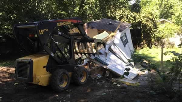 What you need in order to demolish an old house - skid steer