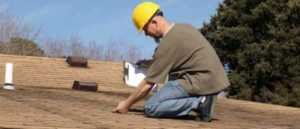 Do I really need a roof inspection this spring - inspector on the roof