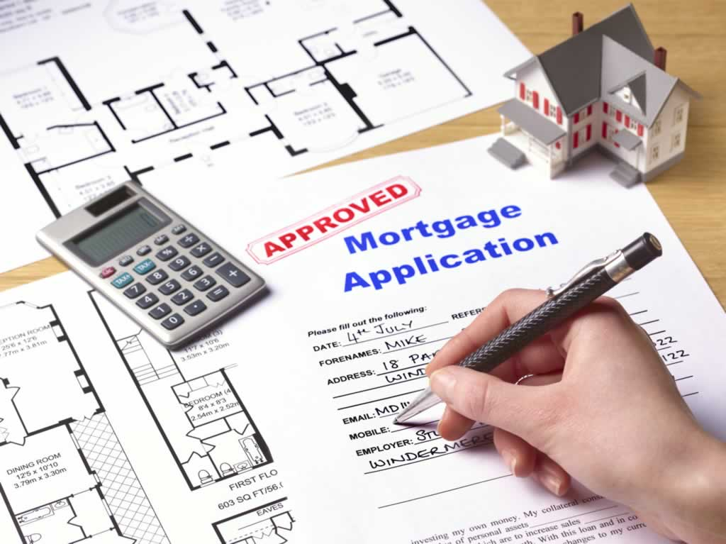 Tips to Choosing the Right Mortgage - signing