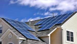 How going solar helps save the planet - roof with solar panels