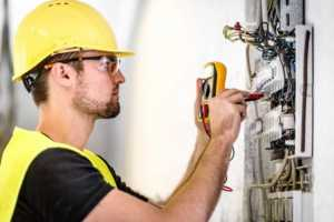 How to find an electrician you can trust - electrician working