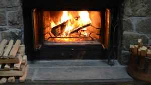 Splitting logs and Firewood for Perfect Use of Log Burner - fireplace