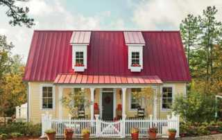 4 arguments why a metal roof is suitable for smaller houses- beautiful small house with metal roof