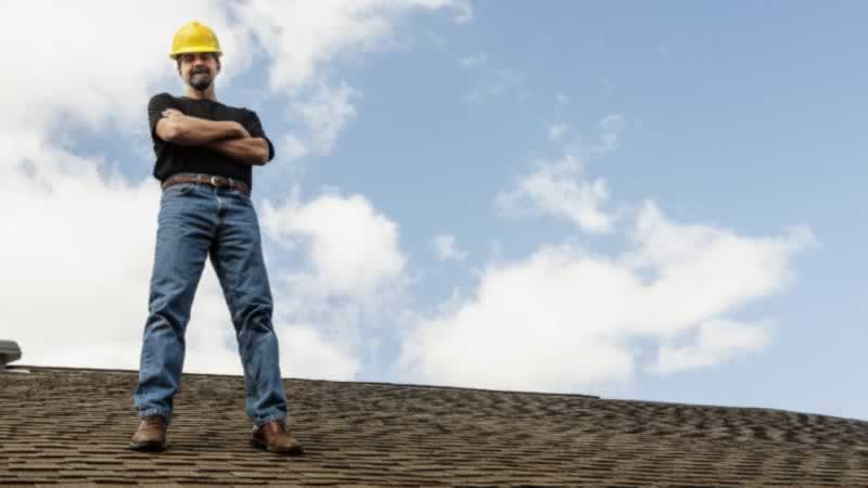 6 questions to ask a roofing contractor when hiring - contractor on roof