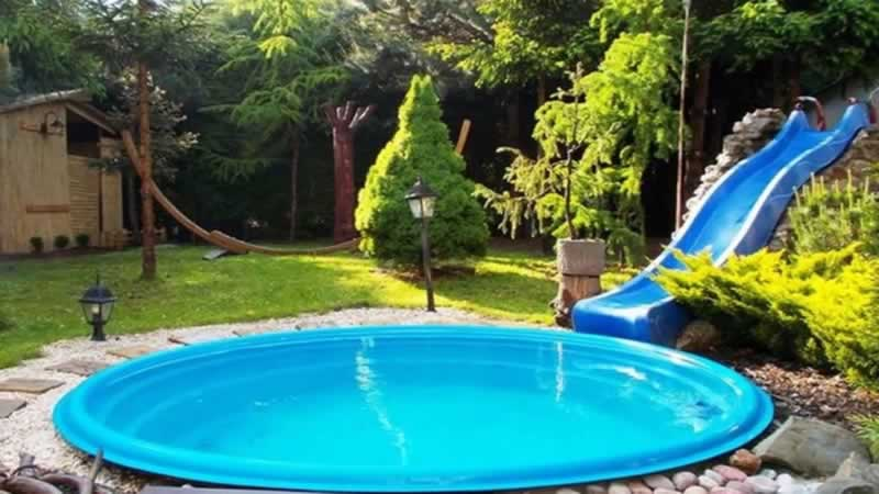 Tips to properly equip your backyard pool - pool with slide