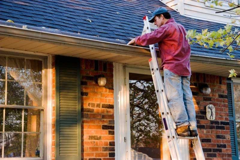 7 Things to Do for a Trouble-Free Home - cleaning the gutters