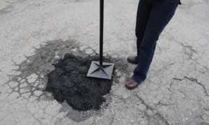 5 signs you need professional help with your driveway - patching a hole