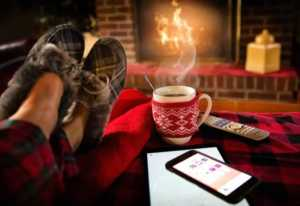 6 Benefits Of A Ventless Fireplace - relaxing in front of fireplace
