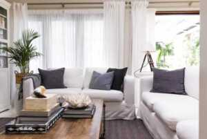 How can I decorate my living room on an eco-friendly budget