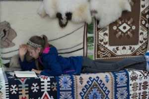 Southwest Interior Design Style and Southwest Rugs - girl on rugs