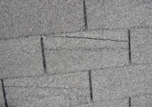 The Right Time to Replace your Roof - cracked shingles