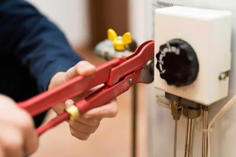 When Should You Replace or Repair a Broken Water Heater - pliers