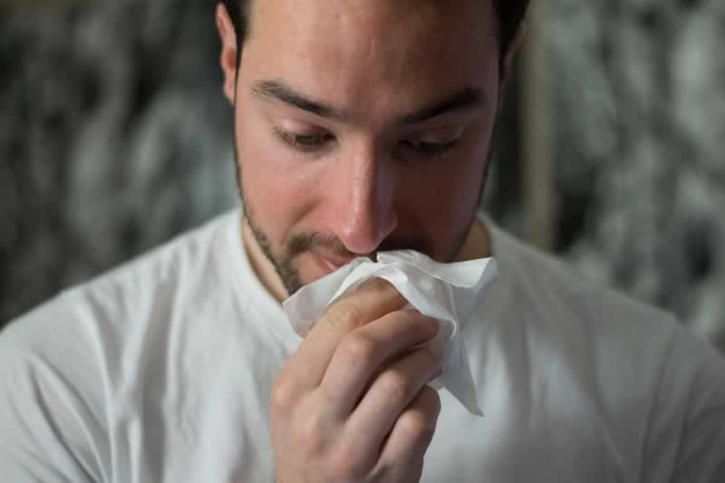 A Basic Guide To Mold - And How It's Potentially Dangerous - men sneezing