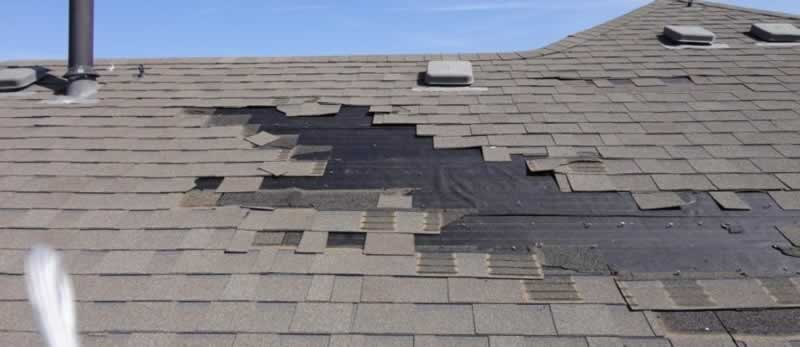 Damaged Roof To Repair or To Replace - wind damage