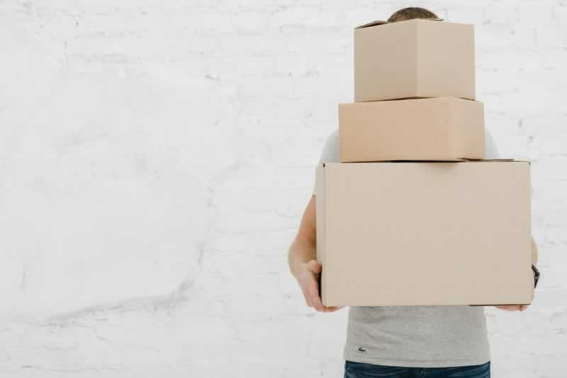 Packing tips that will surely help you while Moving - carrying boxes