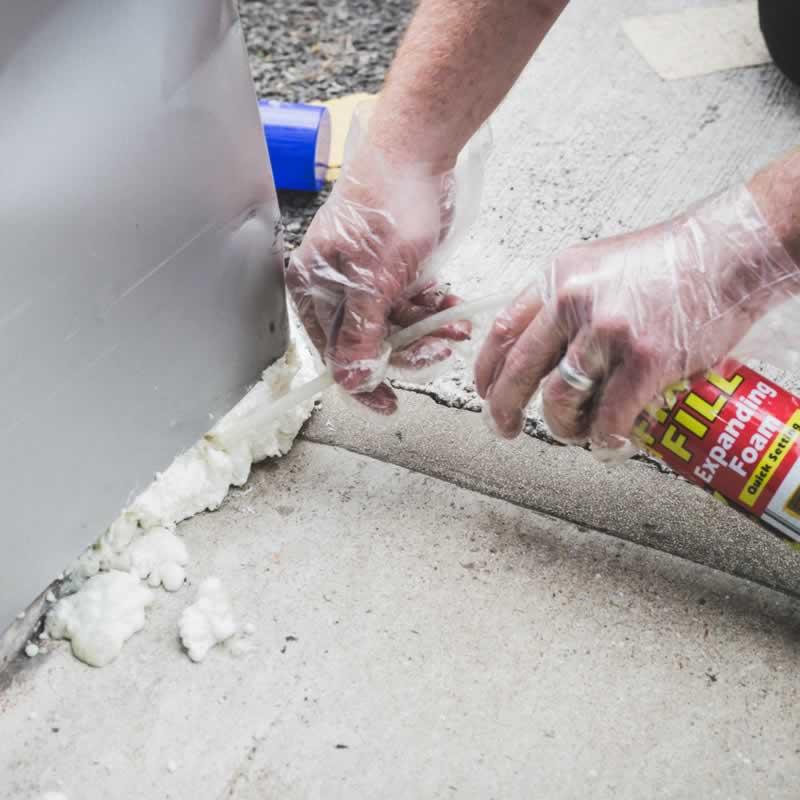 How To Remove Spray Foam Insulation From Your Skin - applying spray foam