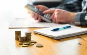 How To Save Your Business Money - calculating