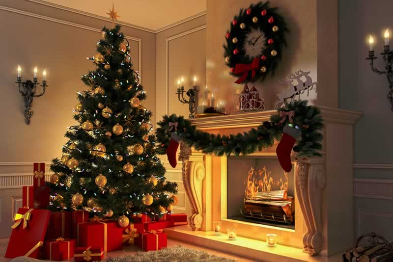 6 Holiday Decorating Tips to Keep Your Family Safe - Christmas tree by the fireplace