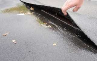 COMMON CAUSES OF COMMERCIAL ROOF LEAKS - seal crack