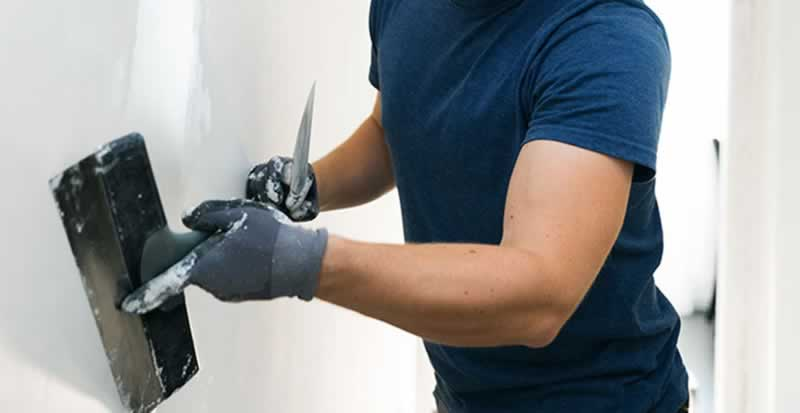 How to Repair & Paint Stucco