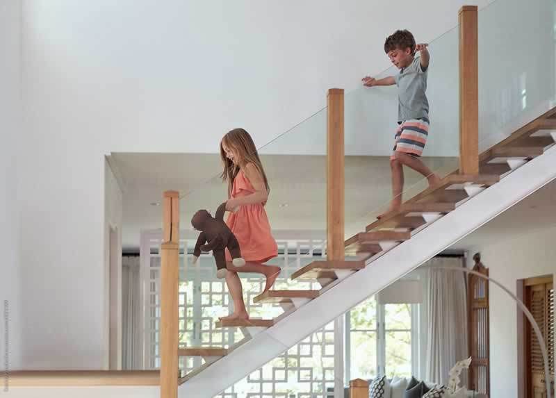 4 Ways to Safeguard Your Kids from Tumbling on the Stairs - kids on stairs