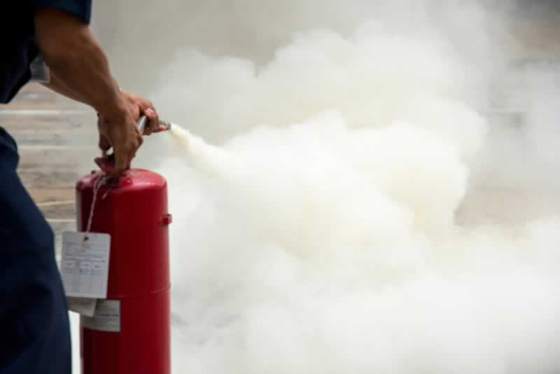 Fire Safety Tips When Renovating Your Home - puting out fire
