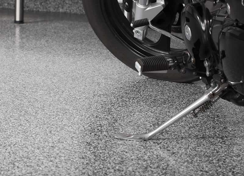 How Can Polyaspartic Coating Enhance the Lifespan of Your Garage Flooring - motorcycle