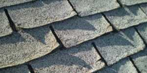 Seven Warning Signs Your Roof Needs to Be Replaced - curling shingles