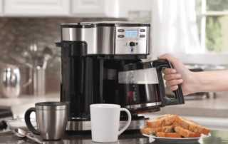 Tips on adding a new espresso machine to your revamped kitchen - pouring coffee