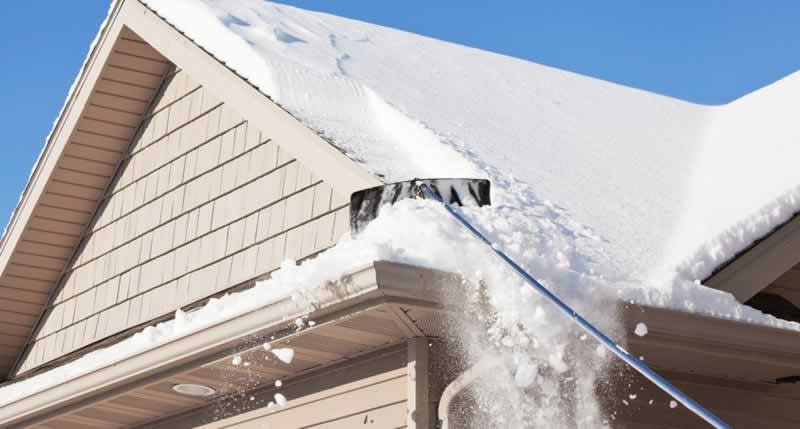 Checking for Roof Damage after Snowstorm - gutters