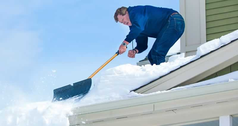 Checking for Roof Damage after Snowstorm