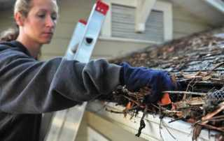 4 Roof Maintenance Tips Every Homeowner Needs - cleaning gutters