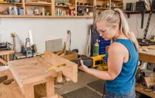 How to Use a Reciprocating Saw - women cutting