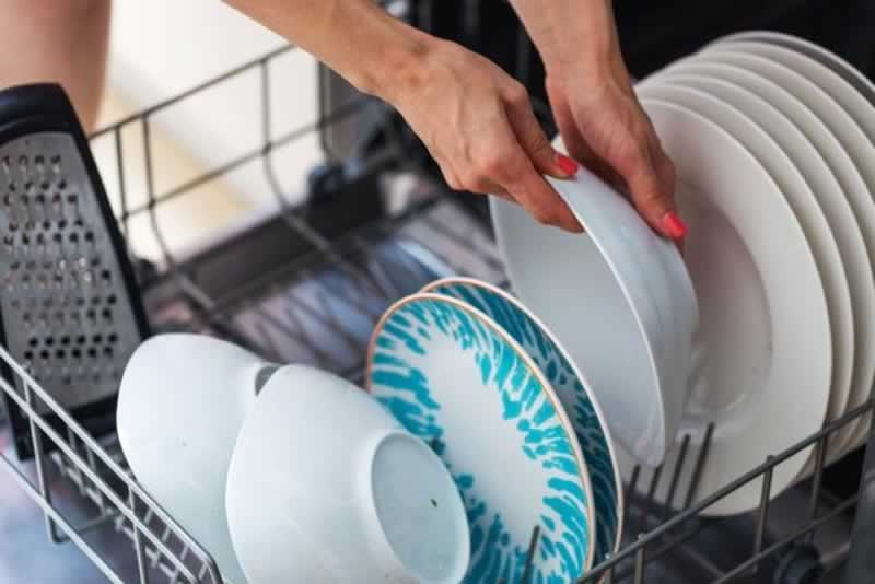 6 Dishwasher Maintenance Tips to Slash the Odds of a Fatal Breakdown - filling the dishwasher