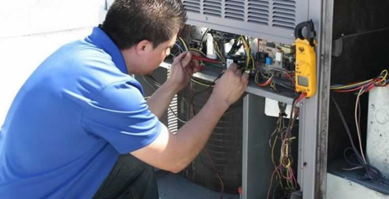 Benefits of Scheduling AC Tune-Up in Jacksonville FL - technician