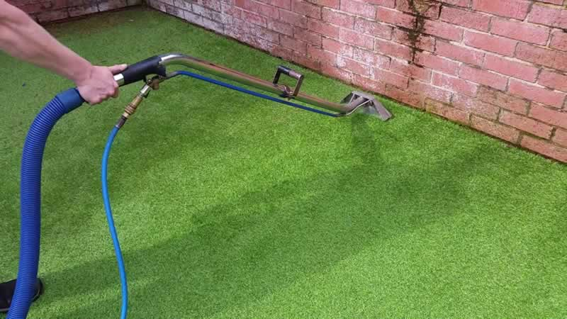How to Clean Artifical Grass - vacuuming