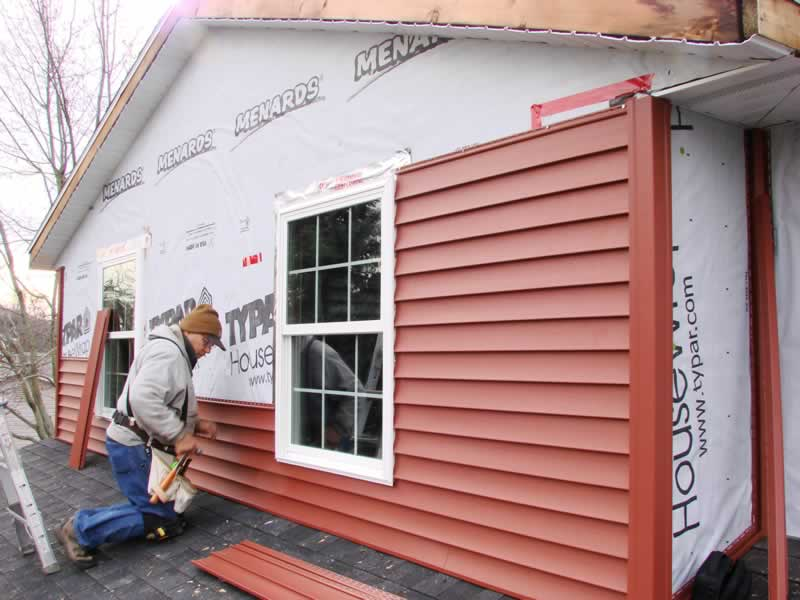 7 Home Renovations That Require You to Have a Permit - installing siding