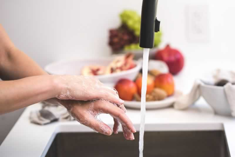 How to Choose the Perfect Faucet for Your Kitchen - washing hands