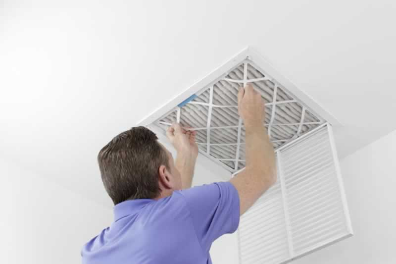 How to Keep Your HVAC System in Tip-Top Shape - changing the filter