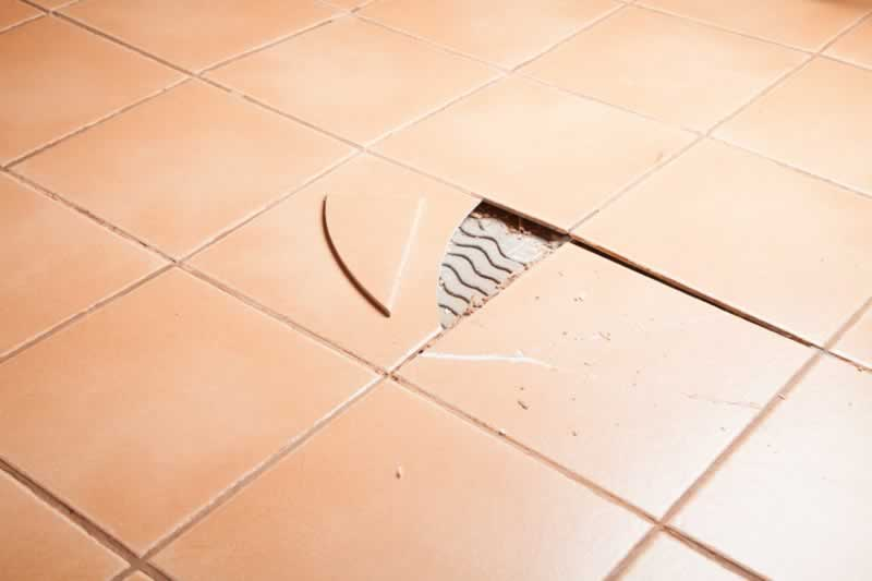 Things You Should always Check to Avoid Costly Repairs - broken tiles