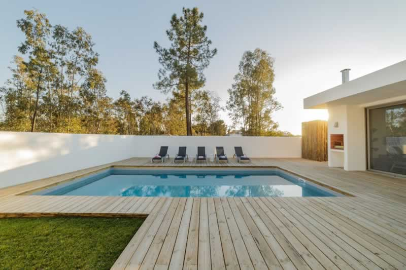 6 Popular Pool Decking Options - wooden deck