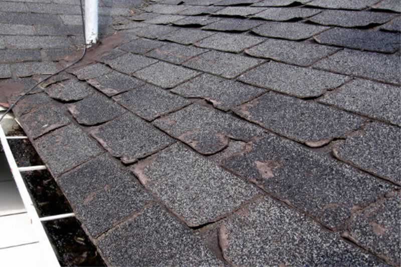 5 Reasons It May Be Time To Replace Your Roof - damaged shingles