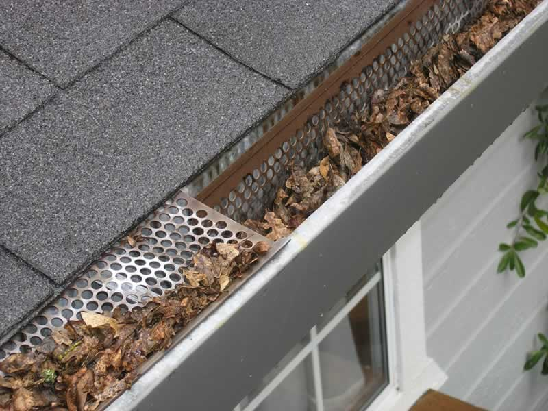 How to Properly Clean Your Gutters - clogged gutters