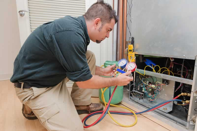 Signs That Your HVAC System Needs to Be Repaired - repairman
