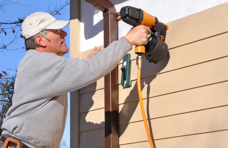 These Are the Essential Siding Tools for DIY - installing siding