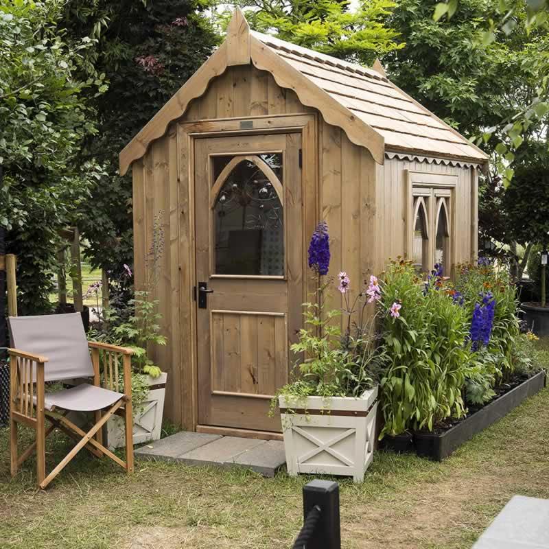 9 Tips to Paint Garden Building - painted garden building