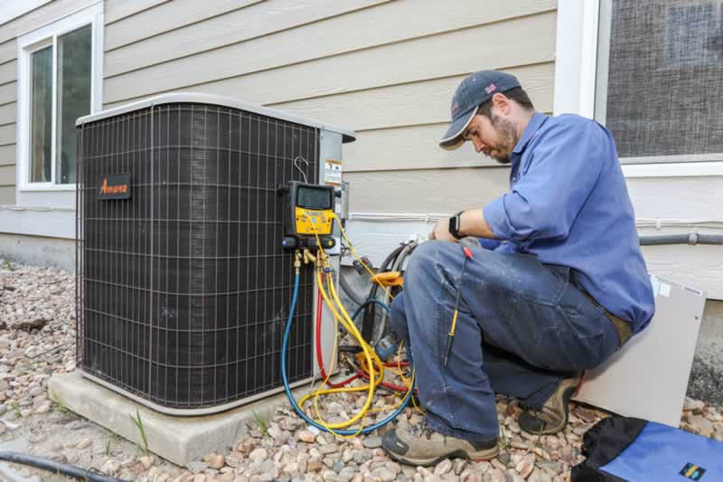 How Much Does It Cost To Have Your Air Conditioner Serviced - servicing